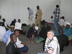 Dr. Ari Greenspan explaing tefillin and Jewish prayer to African Muslims in the prayer room in the Addis Ababa airport