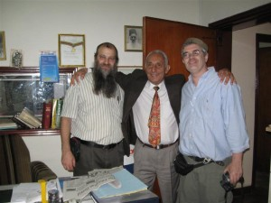 Mr. Kanzen (center), president of the Addis Ababa Jewish community in his office with Ari Greenspan (right) and Ari Zivotofsky