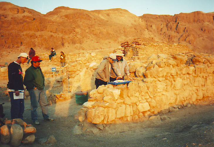 Dr's Greenspan and Pfann evaluating the sundial in situ in the  eastern gate of kumran
