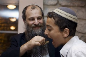 Ari Zivotofsky shares the locust mesorah with his son Yosef